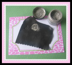 Add embossing powder to stamped clay
